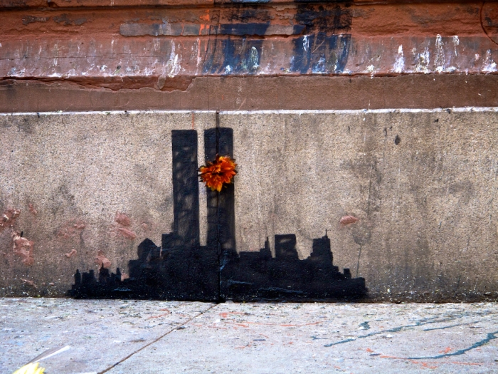 Banksy's graffiti was found in Manhattan's Tribeca neighborhood depicting a silhouette of the World Trade Center's Twin Towers with an orange chrysanthemum singed at the edges.(Arturo Fernandez/Thisissouthwark)