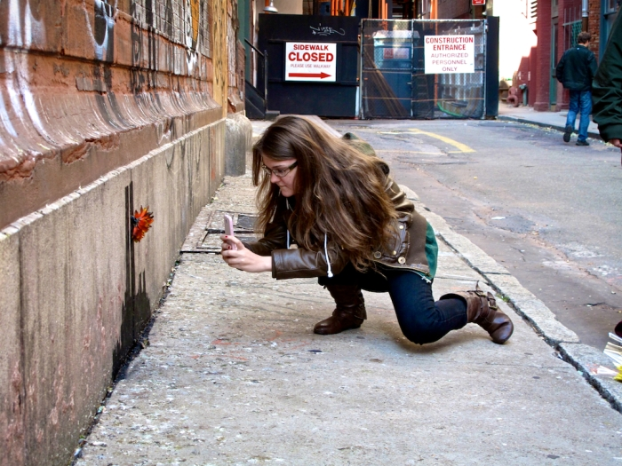 A young fan photographs Banksy's latest creation in TriBeca.(Arturo Fernandez/Thisissouthwark