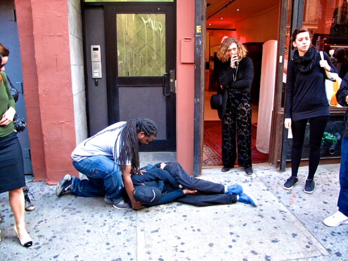 "A member of the ARTCORE crew attends to a unidentified man that was allegedly struck by a strap that snapped off while moving Banksy's ""Crazy Horse"" on Tuesday October 15, 2013.(Arturo Fernandez/Thisissouthwark)"