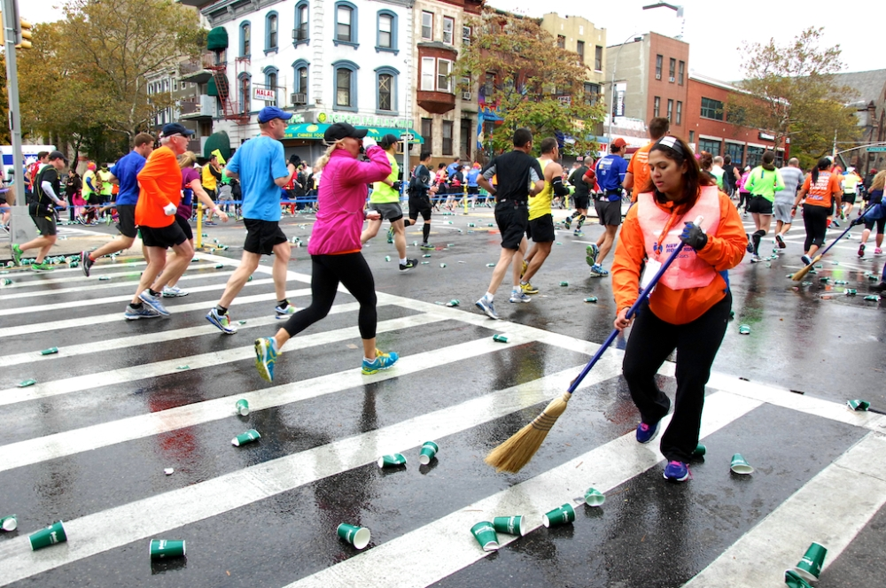 A volunteer cleans up the hundreds of discarded cups along 4th street in Fort Greene, Brooklyn,