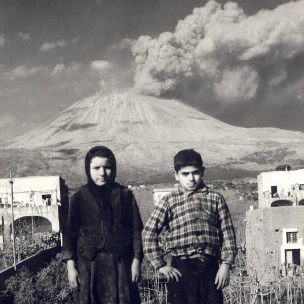 Mount Vesuvius and children from covered homes, San Sebastiano al Vesuvio, Italy.  Photo by Melvin C. Shaffer/1944