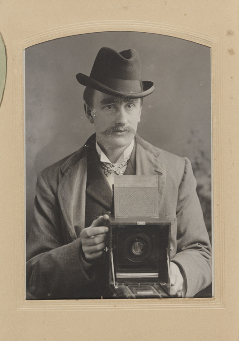 Portrait of Percy Lewis taken by William R. Bland, who was an amateur pictorial photographer who worked as a banker throughout his life. He took up photography aged 40 and became an active part of the local photography community. He exhibited and judged competitions including for the Royal Photographic Society of which he was a fellow. His work was influenced by photographer J. Page Croft.