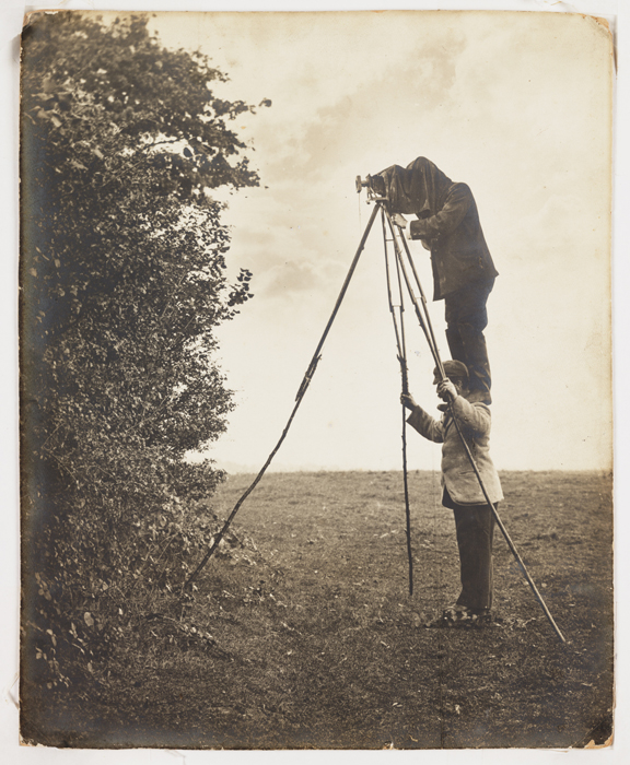 Richard and Cherry Kearton introduced the 'hide' method of bird-watching and photography. Cherry stands on Richard's shoulders to take a picture. The brothers were pioneers of wildlife photography, producing their book 'With Nature and a Camera' illustrated with a 160 photographs in 1899.
