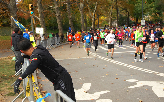 "A runner pauses in Central Park as others reach the ""home stretch""."
