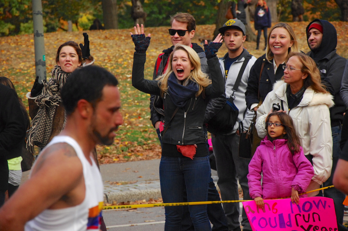 Spectators shout words of encouragement as runners reach the home stretch.
