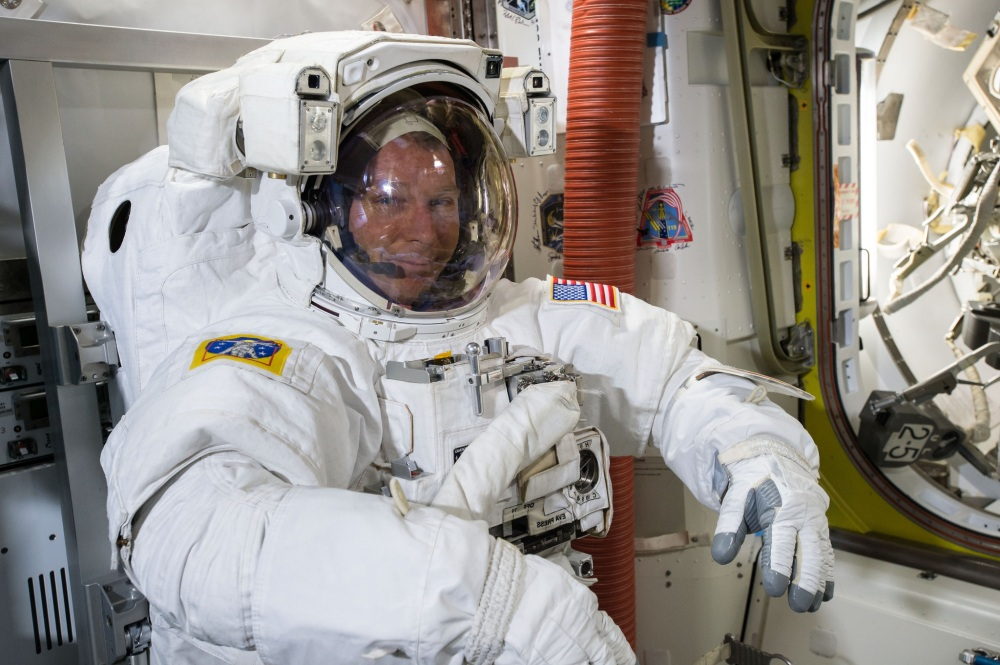 NASA astronaut Terry Virts tries on his spacesuit in preparation for a Feb. 21 spacewalk outside the International Space Station with crewmate Barry Wilmore.  NASA