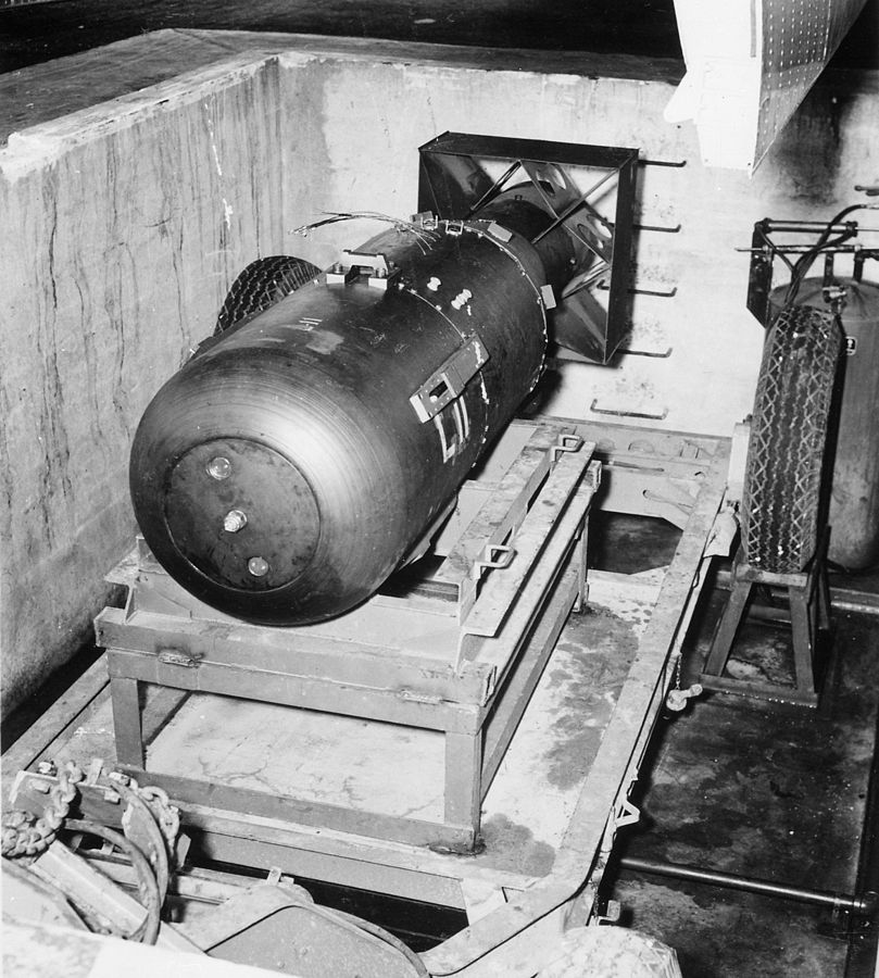 Little Boy unit on trailer cradle in pit on Tinian, before being loaded into Enola Gay's bomb bay.
