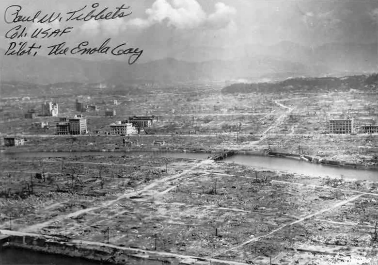 Hiroshima Aftermath, cropped version with writing of Paul Tibbets.  Tibbets was a brigadier general in the United States Air Force and the pilot of the first aircraft to drop an atomic bomb, the Enola Gay.  US Navy Photo